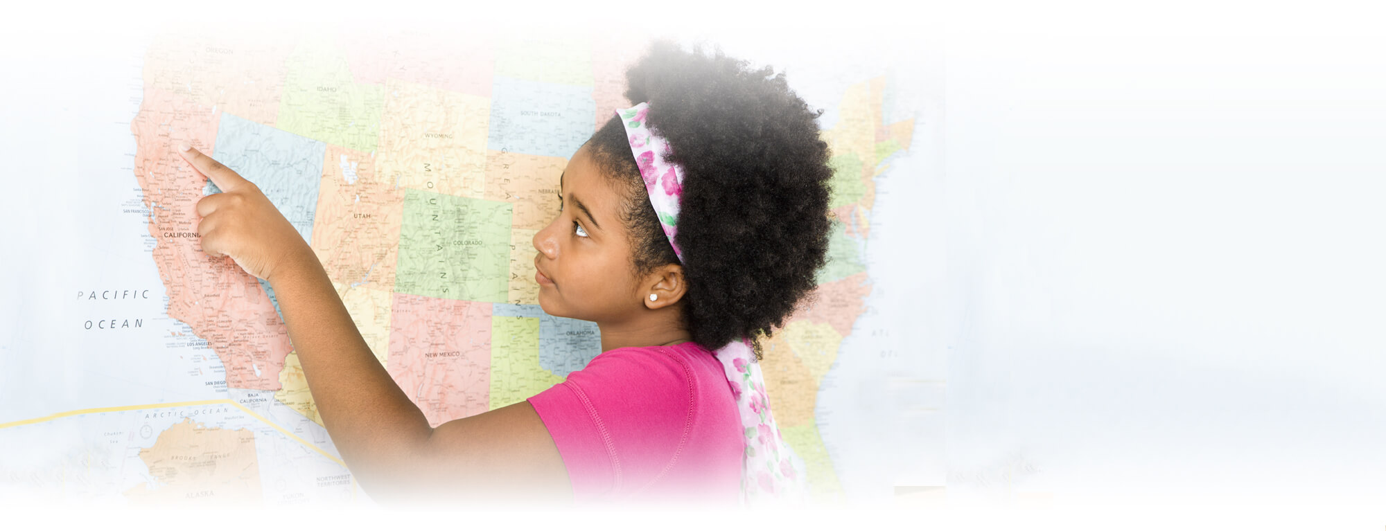 student girl pointing at map of the United States