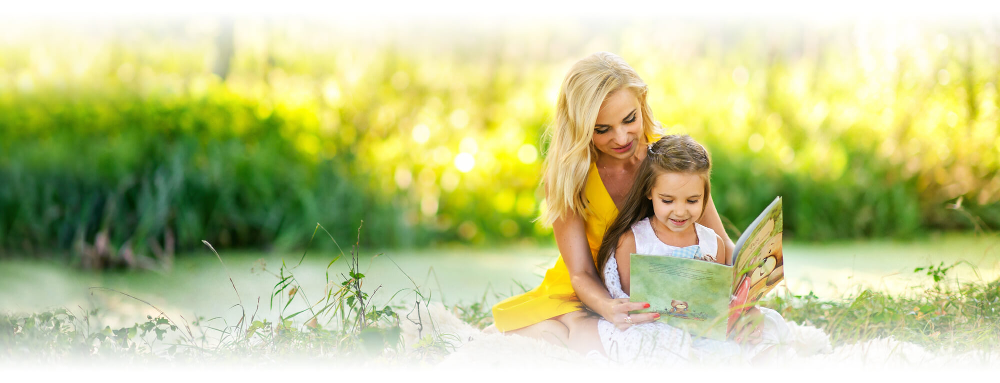 mother and preschool girl reading book